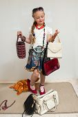 foto of little girls photo-models  - The photo shows a little girl she tries to imitate adults and look fashionable and stylish.