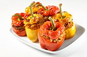 picture of yellow-pepper  - A picture of red and yellow stuffed peppers baked and served on a white plate - JPG