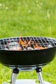 stock photo of ember  - Empty grill on garden with burning embers - JPG