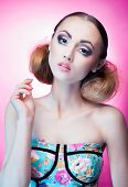 foto of ombre  - Face close up of beautiful young woman with professional party make up wearing flower print top - JPG