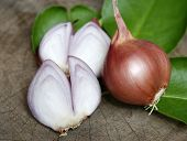 image of red shallot  - Sliced shallot with whole shallots on wooden - JPG