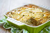 stock photo of zucchini  - casserole with cabbage and zucchini in baking dish - JPG