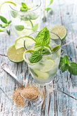 pic of mojito  - Fresh mojito drink on wooden table - JPG