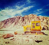 foto of jammu kashmir  - Vintage retro effect filtered hipster style travel image of Bulldozer doing road construction in Himalayas - JPG
