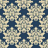 stock photo of damask  - Damask style seamless pattern on blue with a large bold beige repeat floral motif in a busy design suitable for wallpaper and fabric - JPG