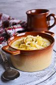 stock photo of eat me  - Thick white soup with pasta and vegetables - JPG