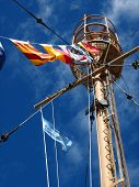 image of wispy  - Columbia Lightship Main Light with Nautical and American Flags Hanging with Wispy Clouds - JPG