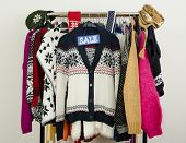 image of racks  - Season clearance rack with colorful winter clothes and accessories - JPG