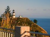 stock photo of coast guard  - Cape Disappointment Lighthouse at Sunset on the Washington Coast USA - JPG