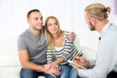 foto of psychologist  - Young happy couple after therapy session with family psychologist - JPG