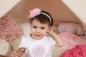 pic of toddlers tiaras  - Toddler child kid engaged in pretend play with a pink flower headband and teepee tent - JPG