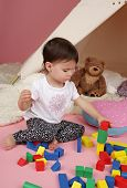 picture of teepee tent  - Toddler child kid engaged in pretend play with stuffed toys and teepee tent - JPG