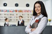 foto of front-entry  - Happy female manager worker standing at hotel - JPG