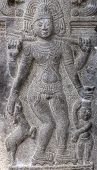 stock photo of beggar  - Sculpture on pillar inside temple complex depicting the beggar - JPG