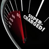 stock photo of speedometer  - Supercharged word on a speedometer with needle racing for a power or energy boost and increasing rate of growth and gaining momentum - JPG