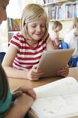 pic of pupils  - Elementary School Pupil Using Digital Tablet In Classroom - JPG
