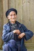 stock photo of centenarian  - An elderly member of the Yao minority people in Tiantou Village - JPG