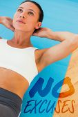foto of crunch  - Determined young woman doing abdominal crunches against no excuses - JPG