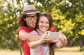 pic of friendship day  - Friends taking a selfie in the park on a sunny day - JPG