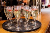 stock photo of champagne glasses  - Champagne glasses on the table before wedding dinner  - JPG