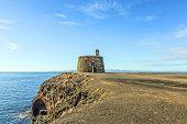 picture of papagayo  - Small castle Castillo de las Coloradas on cliff in Playa Blanca Lanzarote Canary Islands Spain - JPG