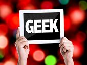 foto of dork  - Tablet pc with text Geek with bokeh background  - JPG