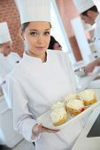 image of confectioners  - Closeup of smiling young pastry confectioner - JPG