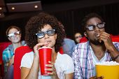 picture of cinema auditorium  - Young couple watching a 3d film at the cinema - JPG