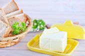foto of margarine  - butter and bread on the wooden table - JPG