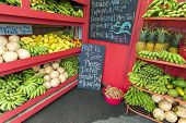 stock photo of papaya fruit  - Pineapples and other fruits for sale at a roadside stand on Maui Hawaii - JPG