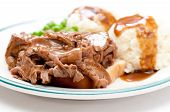 image of diners  - open faced diner style hot beef sandwich with mashed potatoes gravy and fresh vegetables - JPG