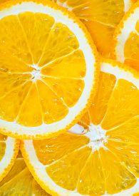 stock photo of orange  - fresh orange orange background Slices of orange - JPG