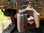 picture of train-wheel  - Train coupling on an old rusty train car - JPG