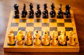 picture of chessboard  - Old Chess standing on ancient wooden chessboard - JPG