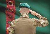 image of turkmenistan  - Soldier in hat facing national flag series  - JPG