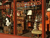 stock photo of bric-a-brac  - pennsylvania corner antique shop window in warm colors  - JPG