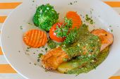 pic of salmon steak  - steak of salmon served with green sauce and vegetable on plate