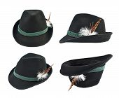 pic of fedora  - Dark fedora like hat with a green tape and a feather isolated over white background - JPG
