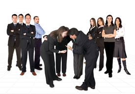 stock photo of women rights  - business men team on the left and women on the right in the middle a mixed team with their heads together - JPG
