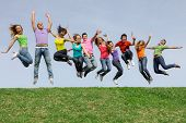 stock photo of jumping  - Happy smiling diverse group of jumping teenager people - JPG