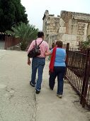 Man And Woman Walking Towards Historical Place poster