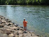 foto of steelhead  - Steelhead fisherman on the bank of the Rogue river near Lost Creek hatchery in oregon usa  - JPG