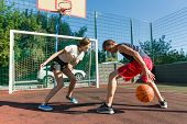 Streetball Basketball Game With Two Players, Teenagers Girl And Boy, Day On Basketball Court. poster