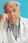 foto of sounding-rod  - Portrait of senior family doctor with stethoscope - JPG
