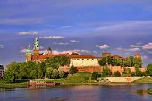 Royal Wawel Castle reflecting in the Vistula river, Krakow - Poland