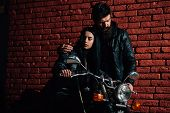 Hipster Couple. Hipster Couple Riding On Motorbike. Hipster Couple On Brick Wall Background. Road Tr poster