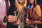 Cropped View Of Glamorous Friends Clinking With Champagne Glasses poster