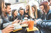 Happy Friends Talking And Having Fun With Mobile Smart Phones At Restaurant Drinking Cappuccino And  poster