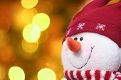 picture of christmas lights  - Festive snowman with a Christmas light background - JPG