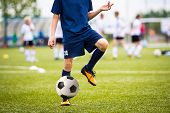 Teenagers Boys Playing Soccer Football Match. Young Football Players Running And Kicking Soccer Ball poster